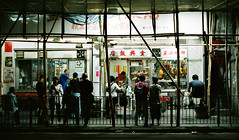 """dinner time"" (hugo poon - one day in my life) Tags: nikonfe2 nikon50mm18 hongkong saiyingpun queensroadwest citynight restaurant eating dinner scaffolding vanishing reminiscing colours people waiting sign"