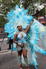 DSC_8235 Notting Hill Caribbean Carnival London Exotic Colourful Blue Costume with Ostrich Feather and Pearl Headdress Girls Dancing Showgirl Performers Aug 27 2018 Stunning Ladies Big Beautiful Woman BBW (photographer695) Tags: notting hill caribbean carnival london exotic colourful costume girls dancing showgirl performers aug 27 2018 stunning ladies blue with ostrich feather pearl headdress big beautiful woman bbw