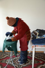 Slave maid on work (Warm Clothes Fetish) Tags: slave maid hijab niqab girl sweat fleece fur hat boots apron winter hot warm coat
