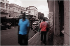 Ghosts in the Town... (Guilherme Alex) Tags: city cityscape citylife citycenter cityday citypulse pulse public people walking citizens citizen stairs bus busstop composition daybyday teófilootoni minasgerais brazil samsung dv100 amateur shot outside exploring angle beautiful woman sidewalk blackandwhite black white buildings windows oldtown oldstyle life living world mycity mylife depressive monocromático wheels traffic jam busy rushhour perspective street ghosts criative red blue shirt fast car children traders building houses tired vision cutout