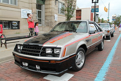 Fresh-Faced Pony (Flint Foto Factory) Tags: flint michigan urban city summer august 2018 home town hometown annual backtothebricks car festival downtown masonic temple 755 ssaginawst saginaw street 1979 ford mustang official pace replica silver argent orange red stripes parallel parked parking beautiful fox body platform front threequarter view brick worldcars