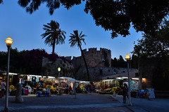 Outside the Walls of Rhodes, by evening (littlestschnauzer) Tags: walls rhodes old city street scene evening 2018 summer holiday market stalls trees palm