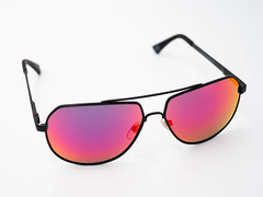 Nahaufnahme einer bunten polarisierenden Sonnenbrille (marcoverch) Tags: bunt sunglasses closeup colorful nahaufnahme sonnenbrille polarized polarisiert polarisierendesonnenbrille eyewear brillen eyeglasses brille eyesight sehvermögen ultraviolet ultraviolett lens linse goggles vision funky plastic kunststoff wear tragen accessory zubehörteil modern glassitems glasartikel protection schutz isolated isoliert fashionable modisch crosshatch kreuzschraffur fashion mode pictureframe bilderrahmen tamron naturephotography wasser fall autumn design outside lego deutschland home