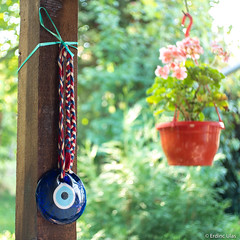 Nazar amulet (✦ Erdinc Ulas Photography ✦) Tags: rope nazar blue white eye amulet turkish traditional turkey ottoman circle red bokeh lenstagger protection culture safranbolu unesco world heritage travel turkiye flower smooth background canon vintage wood garden