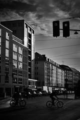 Traffic lights (iamunclefester) Tags: münchen munich traffic lights reflexion monochrome blackandwhite silhouette bike bicycle cars sunset sky clouds windows antenna street
