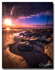 Sun Star (jeremy willcocks) Tags: sunstar wales ukjeremywillcocksc2018fujixpro2xf1024mm sunset colour rocks water sea clouds sand beach marker sky coast northwales wwwsouthwestscenesmeuk jeremywillcocks