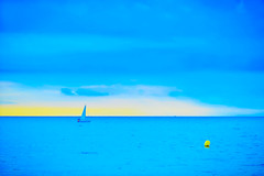 Return at sunrise (Fnikos) Tags: sea water mar mare boat people sky cloud skyline seascape bay sun light sunrise blue blu azul blau outdoor