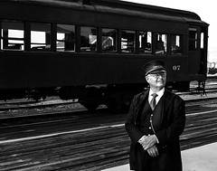 024693763682-103-Train Conductor-3-Black and White (Jim There's things half in shadow and in light) Tags: 2018 america august ely nevaada people southwest train usa conductor mant rail work trainconductor traincar blackandwhite peoplle portrait railroad