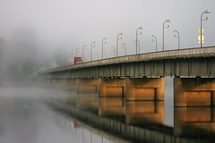 foggy morning (EllaH52) Tags: fog foggy sun light bridge lampposts car lorry water river reflections