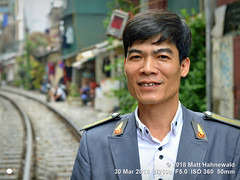 2013-07a Facing Uniforms 2018 (04) (Matt Hahnewald) Tags: matthahnewaldphotography facingtheworld people character head face eyes expression uniform railway consent concept humanity living work dedication travel culture tradition lifestyle safety transport railtrack narrow gap houses urban levelcrossing attendant guard touristattraction hanoi vietnam vietnamese asia asian southeastasian individual oneperson male adult man background nikond3100 primelens nikkorafs50mmf18g 50mm horizontal street portrait halflength closeup seveneighthsview posing incredible authentic duty responsibility occupation job attention senseofduty conscientiousness experience clarity 4x3ratio 1200x900pixels resized middleaged lookingatcamera colour