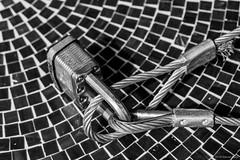 Cable, Lock & Table ©2018 Steven Karp (kartofish) Tags: cable masterlock table tiles philadelphia pennsylvania rittenhousearea fuji fujifilm xt2 monochrome blackandwhite braidedcable