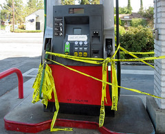 Broken (LeftCoastKenny) Tags: gas diesel fuel pump island red yellow tape text
