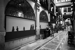 Coffee-drinking among ghosts. (GlebLv) Tags: sony a6000 sigma16mmf14dcdncontemporary spain espana valencia street cityscape passage monochrome bw nb passagederipalda