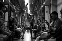 Between saving lives (_storysofar_) Tags: streetphotography spiderman people crowd train blackandwhite monochrome subway underground moscow russia fujifilm