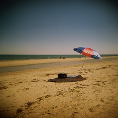 Red and blue beach umbrella (sonofwalrus) Tags: holga film lomo lomography scan beach umbrella henleybeach adelaide southaustralia australia sand water seas ocean beachumbrella red blue shade