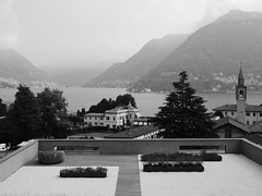 View from above (docwiththecamera) Tags: roof view lake mountain como italy building tree water fog mist