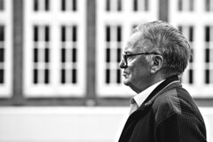 Candid of a Passer-by (d_t_vos) Tags: passerby man oldman windows structure architecture dof contrast glasses hair suit people monochrome lines line square sqyares sideview side face portrait candid outside street streetphotography streetportrait leeuwarden nieuwestad nieuwepijp shop we schwarzweiss zwartwit bw dickvos dtvos