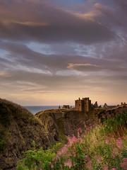 Dunnottar Castle (burnsmeisterj) Tags: olympus omd em1 sunset castle dunnottarcastle stonehaven scotland clouds sky