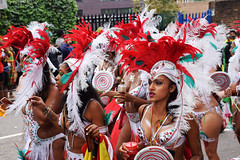 DSC_6868 Notting Hill Caribbean Carnival London Exotic Colourful Costume Girls Dancing Showgirl with Red and White Ostrich Feather Headdress Performers Aug 27 2018 Stunning Ladies (photographer695) Tags: notting hill caribbean carnival london exotic colourful costume girls dancing showgirl performers aug 27 2018 stunning ladies with red white ostrich feather headdress
