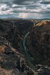 The Rio Grande Gorge (michael spear hawkins) Tags: lenstagger nm adaptedlens arch archbridge august2018 bridge clouds desert erosion mirrorless mountains newmexico outside partlycloudygorge riogrande riograndegorge riograndegorgebridge river sky sony sonya7riii sonymirrorless steeldeck sunset taos town vintagelens canyon landscape cliff rain raining mountain