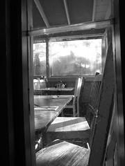 P1410759 (johncocanower) Tags: monochrome blackandwhite bnw bw window chair restaurant table empty santafe newmexico indoor