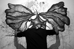 Who needs wings to fly? (Enlivening) Tags: black white wings fly butterfly never stop reflection conceptual room still headless