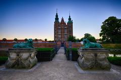 Rosenborg Castle in Copenhagen, Denmark (` Toshio ') Tags: toshio rosenborg castle rosenborgcastle rosenborgslot copenhagen denmark danish europe european europeanunion lions statute royal garden fujixt2 xt2 moat dusk trees