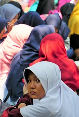 Face in the crowd (Lukim) Tags: face portrait crowd hijab schoolgirl schoolgirls colours picnic zoo jakarta java indonesia streetphotography candid muslim