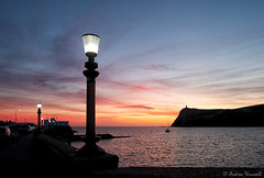 Streetlight at Sunset (manxmaid2000) Tags: sunset sea night light lamp evening samyangrokinon12mmf2 harbour samyangf212mm sky water isleofman boat yacht bay porterin irishsea clouds braddahead coastal fuji samyang lamppost streetlight island peace ocean holiday pier