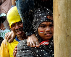 Two expressions (A. Yousuf Kurniawan) Tags: face expression smile streetphotography colourstreetphotography decisivemoment rainy independenceday indonesia culture water closeup humanity humaninterest banjarbaru kalimantan borneo