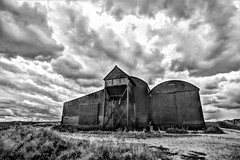 ominous (Paul Wrights Reserved) Tags: clouds cloud cloudscape barn sky skyscape building buildings blackandwhite dark metal grey landscape landscapes landscapephotography door