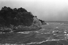 Hells Gate (Harald Philipp) Tags: outdoors rural seascape isolated natural scenic ocean sea bay water waterfront shore holiday vacation tourism tourist exotic destination travel adventure wanderlust island ilford delta400 film grain analog filmphotography 35mm retina sky australia tasmania strahan penalcolony dark rain badweather highseas stormfront lighthouse storm monochrome blackandwhite bw hellsgate macquarieharbour whitecaps oceancurrent doom gloomy hell