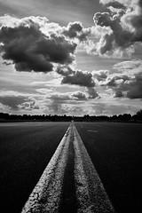 Ground control to Major Tom (iamunclefester) Tags: münchen munich monochrome blackandwhite clouds sky stripe tar runway oldairport vastness bwartaward