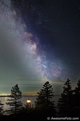 Milky Way over lighthouse (james c. (vancouver bc)) Tags: night park ocean outdoor peaceful rock sky summer autumn tree vancouver water westvancouver britishcolumbia lighthouse blue cloud cliff green yellow orange starburst starfield atmosphere background canada cluster coast constellation galaxy infinite milkyway nature outdoors pacific science sea space star starry stellar twinkle universe vast