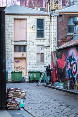 CREATION OF IRON MAN (LA GRANDE TERRE) Tags: alley alleyway artistic artists australia bins boxes canon captainamerica cardboard efs1855mmf3556isii eos1300d graffiti ironman ladder melbourne mural painter painting pavement photoshopcc rubbish sandstone spray vic victoria