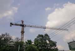 Crane of construction site (phuong.sg@gmail.com) Tags: abstract against background block blue building business city construct construction crane dark design development engineering equipment estate foundation frame heavy high highrise hoist industrial industry lift lifting machine mechanical metal metallic modern new project silhouette site sky steel structure sun tall tower urban work