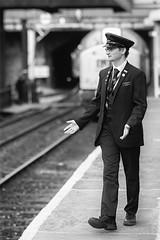 Train? What train? (Mister Oy) Tags: train loco station elr guard uniform walking mono monochrome blackandwhite nikond850 nikon85mmf14gafs bokeh