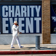 Charity Event (www.karltonhuberphotography.com) Tags: 2018 citystreets karltonhuber man peoplewatching phone santaana sidewalk southerncalifornia streetphotography talking walking white windows