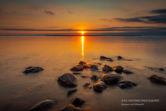 Sunset at Lake Superior (susannevonschroeder) Tags: lakesuperior wisconsin clouds rocks summer sunset