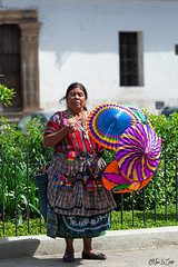 Umbrellas (Nino La Corte) Tags: people traditional wear color outdoors street portrait culture dress costume veil guatemala woman umbrellas