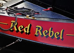 Red Rebel (eMAJgen) Tags: red canal barge narrow boat mercia marina lettering photo challenge