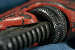 Macro Mondays, Cogwheel (jamesallen9) Tags: macromondays cogwheel wrench stilsons pipe orange rigid