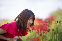 Young woman closer looking at red spider lily (Apricot Cafe) Tags: img107813 asia asianandindianethnicities canonef85mmf14lisusm healthylifestyle japan japaneseethnicity kasairinkaipark tokyojapan autumn beautifulwoman capitalcities casualclothing charming closeup colorimage copyspace day flower happiness leisureactivity lifestyles looking nature necklace oneperson oneyoungwomanonly onlywomen outdoors people photography portrait publicpark realpeople redspiderlily selectivefocus shortsleeved sideview sitting sky smelling smiling straighthair waistup women youngadult tokyo tokyoprefecture jp