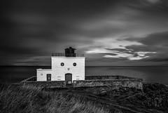 Shocked (Ade G) Tags: bw buildings coast lighthouse seascape