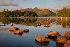 Derwentwater Golden Hour (Andy Watson1) Tags: derwentwater lakedistrict goldenhour keswick catbells lakedistrictnationalpark reflection derwentisle cumbria england unitedkingdom greatbritain morning rocks fence fells mountains summer august landscape view scenery photography longexposure travel holiday canon70d mist