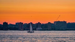 Flying/sailing by at sunset - Hoboken, New Jersey (Andreas Komodromos) Tags: airplane boat buildings city cityscape dusk hoboken hudsonriver newjersey newyork night nightscape nyandreas river sailboat skyline sunset water sunlight colorful color colour dramatic landscape