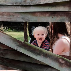 Me and baby brother. War. ( Not our fence 😉 ) (ianmiller6771) Tags: kids gardenfence happy smile candid fujixe2 youngchildren playtime blueeyes blond brotherandsister eyecontact