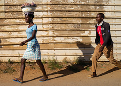 Angolan man and woman walking in the street, Huila Province, Lubango, Angola (Eric Lafforgue) Tags: adults adultsonly africa angola angola181084 angolan carrying colourimage dailylife day developingcountries facade fulllength horizontal huilaprovince lubango men outdoors photography street twopeople walking women