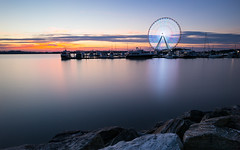 National Harbor (sk_husky) Tags: sunset sky sea water bay washington districtofcolumbia dc nationalharbor ferriswheel rocks boats clouds canon nisi