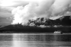 2010-05-26 Ship Harbor (B&W) (2048x1360) (-jon) Tags: anacortes skagitcounty skagit washingtonstate washington salishsea fidalgoisland sanjuanislands shipharbor guemeschannel rosariostrait ferry boat ship vessel wsf wsdot washingtonstatedepartmentoftransportation pnw pacificnorthwest pacific ocean pacificocean sea water bw blackandwhite seascape landscape clouds mountain a266122photographyproduction d40archives cypressisland cypress washingtonstateferries